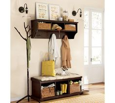 Love entryway/mudroom storage. This entryway shelf & bench is $628 for mahogany from Pottery Barn. (Baskets and bench cushion sold separately.)