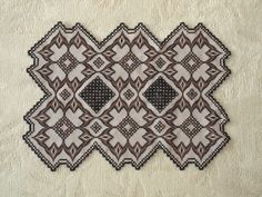 Hardanger and Bargello.  25 count Pewter Lugana fabric and Caron Wildflower floss in Sable and a medium brown.