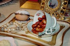 Haftseen or the seven 'S's is a traditional table setting of Nowruz. The haft seen table includes seven items all starting with the letter seen (س) in the Persian alphabet.  ~ Senjed - dried oleaster fruit - symbolizing love  ~ Eggs - symbolizing Fertility    ~ Bita Taherian Design & Photography  www.bitataherian.com Romantic Dinner Tables, Romantic Picnics, Romantic Dinners, Persian Alphabet, Haft Seen, Side Dishes For Salmon, New Year Table, Iranian Cuisine