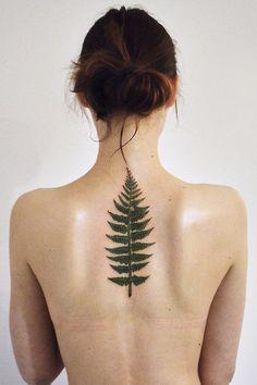 Dark-green tree leaf tattoo on back - Tattoos.pm