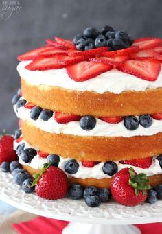 Fresh Berry Vanilla Layered Cake - layers of moist vanilla cake flavored with pureed strawberries and blueberries, layered with fresh berries and whipped cream!  #pictureperfectplate