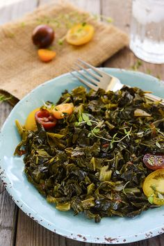 Delicious Vegan Southern-Style Collard Greens simmered in onion, garlic, tomatoes and aromatic spice for an authentic taste of the South without meat!