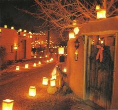 Taos Pueblo with luminarias, Christmas. Beautiful southwest décor. Stay at the Adobe & Pines B&B. Historical Taos property. #innforsale