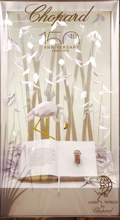 Elemental Design created these installations for Chopard's 150th anniversary Animal World collection. The jewellery is displayed on hand bound books, each telling a story featuring the jewelled characters and surrounded by intricate origami.