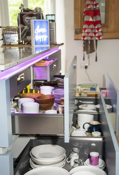 Specifications are: Masterclass units - Sutton Silk H Line Light Grey, with island in Coastal Mist Aluminium effect handle rail Blum drawer hardware  Other: Worktop Tutti Frutti Quartzstone Bespoke elm breakfast bar (with a lovely butterfly feature) Splashback Merlot Decoglaze glass NEFF appliances: Slide & Hide ovens, Compact Oven with Microwave, Flexinduction Hob & Ceiling hood Dimable colour changing feature lighting suite Quooker tap Blanco sink