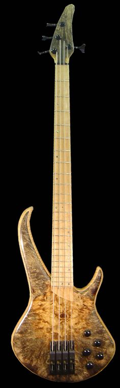 That's one FUGLY headstock!  SEI Lightwave Bass-4...@ www.seibass.com