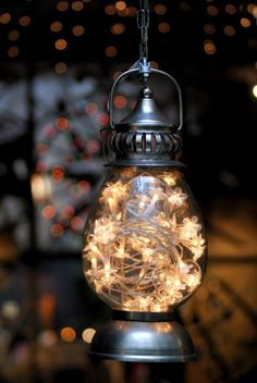 Hanging lantern filled with a strand of twinkle lights.