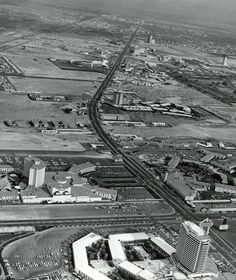 Las Vegas Strip, early Looking north from Dunes Hotel. Construction can be seen on the front section of Flamingo Hotel. Water flows at Flamingo Wash, from Caesars to Flamingo Capri. Las Vegas Blvd, Las Vegas Strip, Las Vegas Nevada, Las Vegas Photos, Vegas Shows, Caesars Palace, Aerial View, Old Photos, Marvel