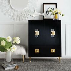 I'm back to work and feeling pretty refreshed. Here's a little #glam morning design inspiration via @cocorepublic. Loving the sleek lines and fab finish of this Jonather Adler cabinet. It's a bar cabinet but I think it would make an awesome entryway piece too. Who wouldn't want to be welcomed home by this #gorgeous sight? . . . .  #blackandwhite #gold #decoration #makehomeyours  #passion4interior #homesweethome #homestyle #home  #interior4all #hgtv  #influencer #makeover #instaroom…