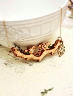 Strangely Yours // MOVABLE Woodland Birds on branch-  intricate woodwork necklace. $23.90, via Etsy.