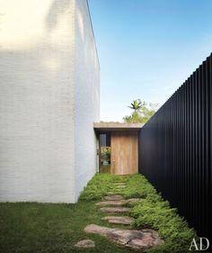 black white timber brick stone and garden