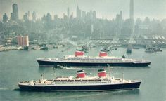 United States Lines vessels the United States (1952) and the America (1940) pass each other in New York.
