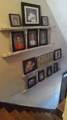 Use an old ladder as a shelf for photos! Cute idea!