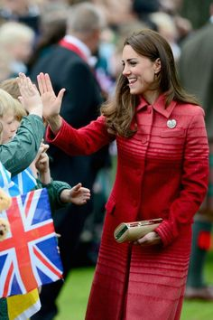 Catherine Duchess of Cambridge greets dignitaries at MacRostyy Park... News Photo 494273405 High five!  LOVE IT!