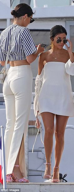 High spirits: Although Kendall made sure to stop and check her phone as she and Kourtney m...
