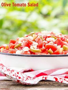 Olive Tomato Salad is wonderful for summer entertaining. Garden-fresh tomatoes and cucumber are mixed with olives, feta cheese, shallot, and tossed with a light oil and vinegar dressing. #SundaySupper