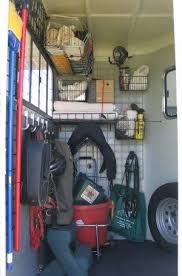 trick to organizing a horse trailer! It's this system! And then it can pop out of the trailer and onto the stall wall at the horse show! This will be a MUST over the next couple of years when I'm planning to practically live in my horse trailer/truck. Horse Trailer Organization, Tack Room Organization, Trailer Storage, Horse Stables, Horse Barns, Riding Stables, Horse Camp, Charro, Horse Tips