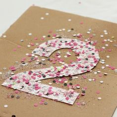 Make a New Year's Eve garland out of numbers and confetti