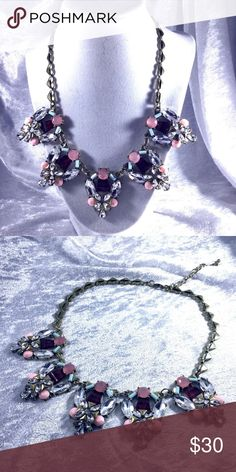 """Glam Statement Crystal Necklace with Red & Pink Beautiful statement necklace with clear crystals, red, and pink Opal moonstone style crystals. 19"""" adjustable chain. High end costume jewelry in metal alloys, brass, stainless steel. Chain is in shape of hearts. Save the most with bundles. I offer 25% off on bundles of 2+ items. I accept reasonable offers. No trades. I only do business on Poshmark. Boutique Jewelry Necklaces"""