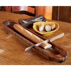 This tray's smart design lets you cut 12 perfect slices. Made of food-safe, sustainable acacia wood.