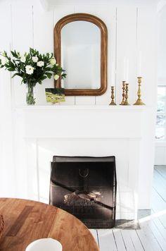 white, wood, brass candlesticks