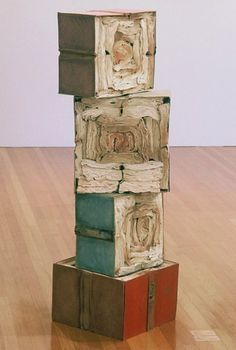 """Jacqueline Rush Lee    'Stack' 50"""" high, from the Volume series created in 2000. The books are wet, dried, then screwed together into organic and geometric forms.  www.jacquelinerushlee.com"""
