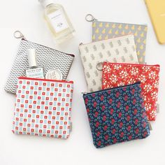 Iconic Unique pattern medium zipper pouch by ICONIC. The Unique Pattern medium pouch is a well made and lovely zipper pouch with a beautiful pattern.The Medium Pattern Pouch is one of many adorable and functional products in the MochiThings collectio Zipper Bags, Zipper Pouch, Fabric Stamping, Pouch Pattern, Pencil Bags, Fabric Bags, Sewing Projects For Beginners, Gadget, Purses And Bags