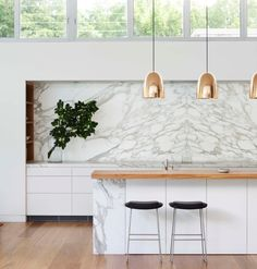 Kitchen: marble & copper pendants for island. Like the mix of elements.