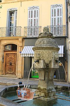Clever restaurant using the fountain to cool their rosé wine. Aix-en-Provence, France