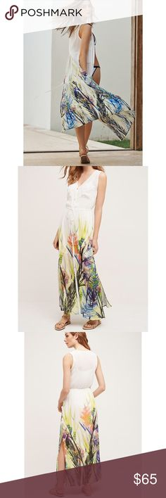 """Anthropologie Watercolor Dress Anthropologie Watercolor Dress. The perfect vacation/summer dress. White with multicolored floral print bottom. V neck. Side slits. Button front. Drawstring waist. Slightly sheer fabric. Mother of pearl buttons. XS petite underarm to underarm 14.5"""", length 52"""". Small underarm to underarm 15.5"""",  length 58"""". Measurements are approximate. Anthropologie Dresses Maxi"""