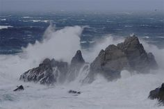 ocean waves in storm | foot high waves pound the rock outcrops and beaches and after a storm ...