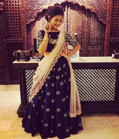 Beautiful blue color lehenga and designer blouse with ivory net dupatta. Lehanga and blouse with hand embroidery thread work.  29 November 2017