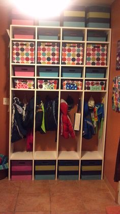 Kids Lockers! Of all the different organization projects I've done around the house...this has been my favorite! The bottom bin is for shoes. Then they can hang their coats and backpacks. I use the small bin above that for their hats, mittens, socks (for some reason they always show up in the mudroom with no socks). Above that is a bin for their school papers we need to keep. Above that is a big bin for out of season stuff ( snowpants, beach towels, rain coats, etc). We use...