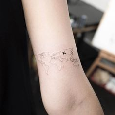 world map tattoo small plane