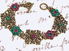 $35  Victorian filigree bracelet with Swarovski Amethyst and Emerald crystals. Romantic and elegant!