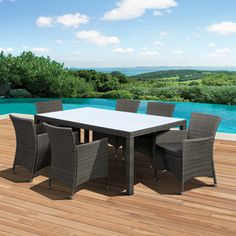 International Home�7-Piece Cushioned Wicker Solid Patio Dining Set table 79x38 $1,749 Lowe's
