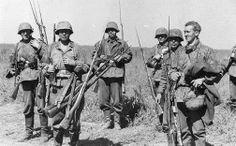 Waffen SS riflemen pose for the photographer carrying bundles of Russian Mosin Nagant rifles, complete with bayonets, somewhere in Russia. The Mosin Nagant remained the main issue rifle for the Red Army during the war despite its age. The MN was of simple operation and practically indestructible.