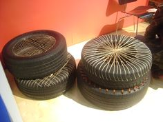 used tires as seating - drill holes where you want to thread the rope, macke sure the rope crosses enough to be structural yet comfortable. Could be cool with brightly coloured rope.