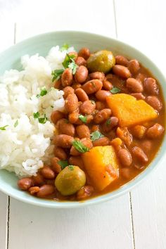 Flavorful Puerto Rican rice and beans simmered in a sauce of sofrito and tomato along with potatoes and olives. Classic Puerto Rican recipe!