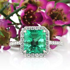 This spectacular natural emerald and round brilliant cut diamond ring is enchanting! The mesmerizing 2.29ct square emerald cut emerald showcased in the center of this astonishing ring is GIA certified.