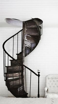 = iron spiral staircase and white
