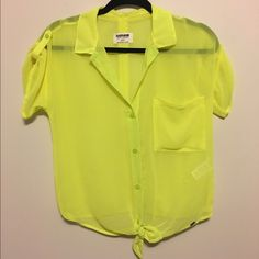 Garage Neon Chiffon Shirt NWT Garage Neon Chiffon Shirt! Adorable neon yellow short sleeve button-up with pocket and tie at bottom. Garage Tops