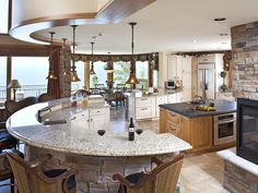 This is a great Enternating space! The open fireplace in the kitchen, the island and curved bar!