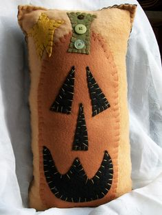 Primitive Pumpkin Face Pillow.