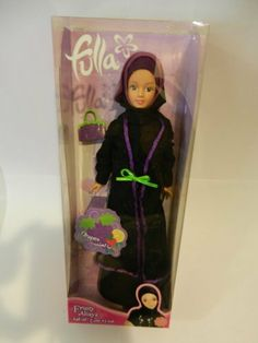 Purple Fulla Muslim Doll Arabic Toy Hijab Eid Gift Fruity Abaya Grapes by NewBoy. $29.99. Fulla Muslim doll from NewBoy. Fruity Abaya in Purple (grapes)! The perfect Arabic girl doll Eid gift after Ramadan.. Fulla is wearing a white and purple striped shirt. Her all white skirt has a printed bunch of grapes and she is wearing purple matching high heeled shoes. Fullas black abaya has purple trim and she is wearing a black hijab (Muslim head cover) with purple trim. To co... Black Hijab, Black Abaya, Eid Gift, Wearing Purple, White Skirts, Doll Accessories, Girl Dolls, At Least, Creative Play