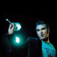 Morrissey on stage - wearing a West Ham t-shirt - during his Oye Esteban! Tour (1999) — image via El Pais http://elpais.com/elpais/2013/11/28/icon/1385654194_131291.html