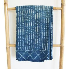 This Vintage Style African Mudcloth textile was handwoven in Mali, West Africa with a resist dye pattern that is typical of the region. This is a rare vintage find and it is as soft and supple as you can imagine. This textile features a traditional motif and we geometric quality of the arrow shapes. This textile will make a great addition to your home tossed over the back of your sofa, at the foot of your bed, or as a temporary layer to your headboard or a bench. Bring a bit of the world…