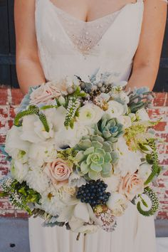 succulent and mixed floral bouquet, photo by Sloan Photographers http://ruffledblog.com/glam-carondelet-house-wedding #wedding #bouquet #flowers