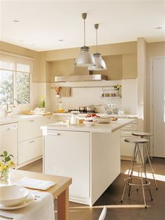 If your tiny kitchen is L-shaped or along one wall, adding an island — even a little one — can be a great way to include extra counter space, dining and maybe even a home office. (via The Glitter Guide) Kitchen Dinning, Dining, Island Kitchen, Dream Decor, Ideal Home, Home Kitchens, Kitchen Remodel, Kitchen Design, Sweet Home