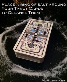 Place a ring of salt around your tarot cards to cleanse them between readings. Click on the link for more easy and creative ways to bless your cards. #tarotcards